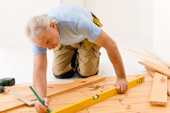 Home improvement - handyman installing wooden floor